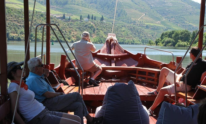 tourists inside rabelo boat douro river cruise