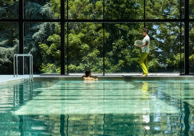 woman swimming pool six senses douro valley
