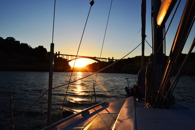 romantic sunset sailing boat porto arrabida bridge douro river
