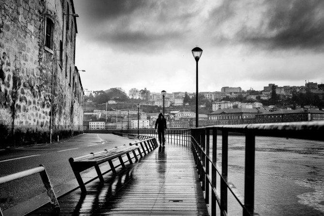 rainy days porto man walking ribeira neighborhood