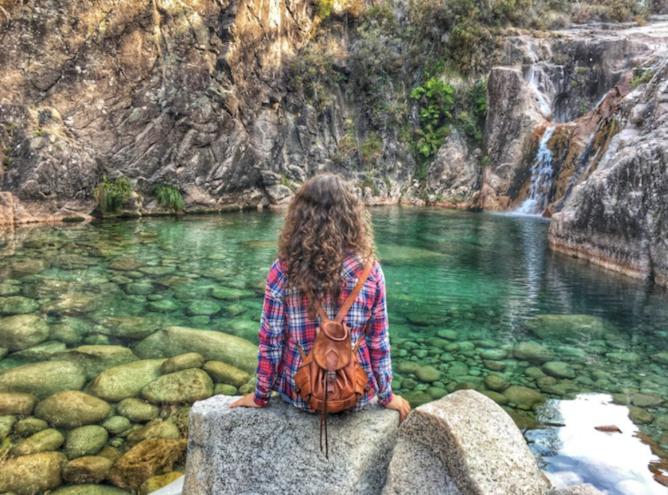 woman at portela homem waterfalls geres